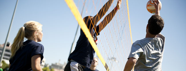 Volleyball players at the net