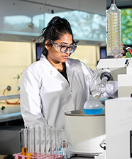 Research tile-Female Researcher in Chemistry Lab 2020 1x