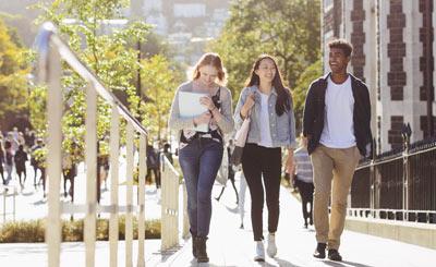 3 future students walking through campus.