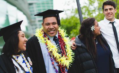 4 Alumni at a Graduation.