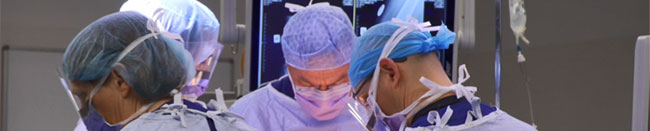 Close up of orthopaedic surgeon Gary Hooper at work in the operating theatre
