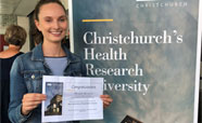 Summer Student Annabelle Greenwood showing her best laboratory presentation award certificate_thumbnail