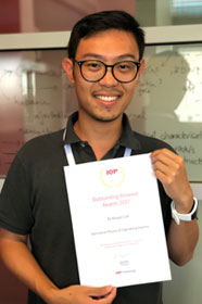 Dr Khoon Lim holding his Outstanding Reviewer certificate (2017)