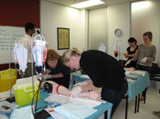 4th Year students practice venepuncture at UOC Simulation Centre during 2012 Introductory Fortnight