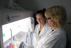 Gabi Dachs and Lizzie Campbell working in the lab