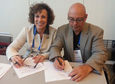 John Dean and Pamela Jeffries signing affilliation agreement between NZASH and SSIH