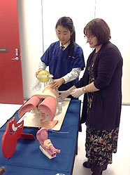 MaryLeigh Moore and a student from Rangi Ruru Girls High School GATE programme learning Airway techniques on a part-task trainer at the Simulation Centre