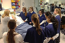 "Niki Newman demonstrating the capabilities of SimMan3G ""Alex"" to a group of students from Rangi Ruru Girls High School GATE programme"