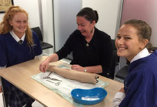 Dr Laura Joyce gives a suturing demonstration to Rangi Ruru students at the Sim Centre