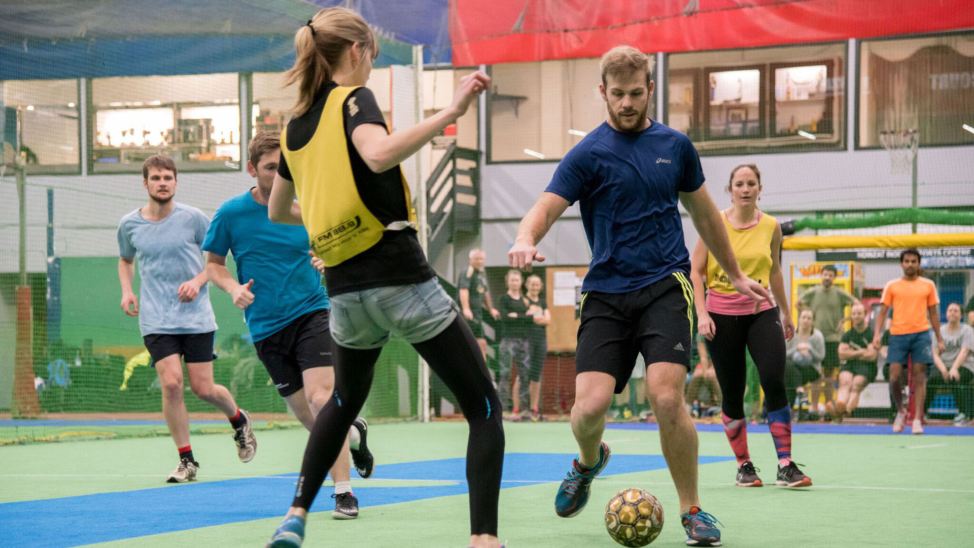 Vanessa and George face off in staff versus student soccer (2017)