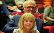 Michael Baker and daughter listening to public lecture on Storytelling