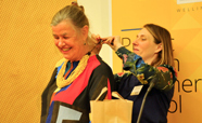 Nathalie Robbel presents gift to Phillippa Howden-Chapman in recognition of her global contribution to healthy housing