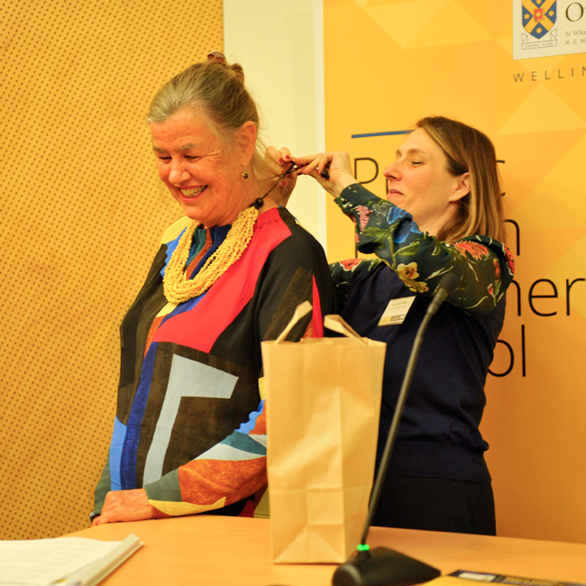 Nathalie Robbel presents gift to Phillippa Howden-Chapman