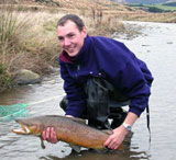 Ed Waite with a large Brown trout (M.Sc research on trout   migration)