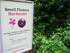 Smokefree outdoor signs - smell flowers not smoke