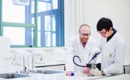 Postgraduate student and supervisor in the lab